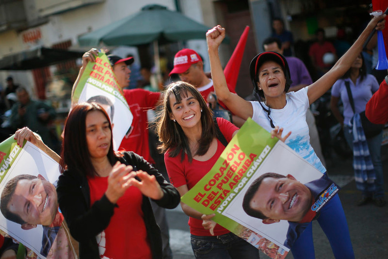 . Supporters of Venezuela\'s President Hugo Chavez cheer outside the military hospital after his surprise return to Caracas February 18, 2013. Chavez made a surprise return from Cuba on Monday more than two months after surgery for cancer that has jeopardized his 14-year rule of the South American OPEC member. The 58-year-old socialist leader underwent a six-hour operation in Cuba on December 11. He had not been seen or heard in public since then until photos were published of him on Friday. REUTERS/Jorge Silva