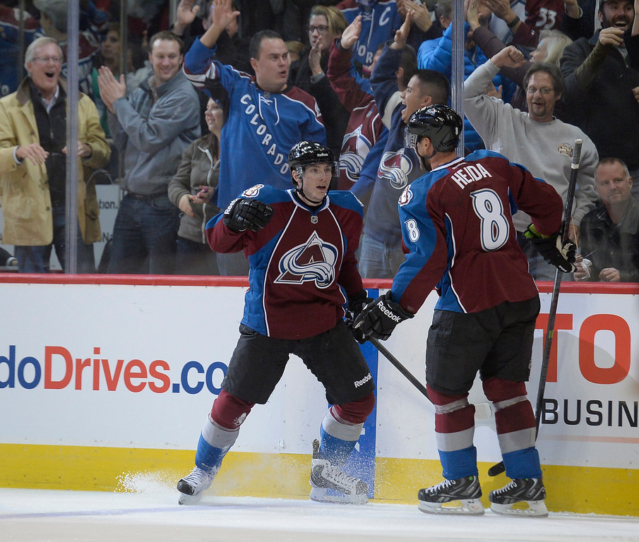 . ENGLEWOOD, CO - NOVEMBER 06: Colorado Avalanche center Matt Duchene (9) celebrates his goal with Colorado Avalanche defenseman Jan Hejda (8) during the third period November 6, 2013 at Pepsi Center. Nashville Predators defeated the Colorado Avalanche 6-4. (Photo by John Leyba/The Denver Post)