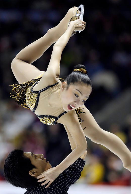 . Sui Wenjing and Han Cong, of China, perform during the pairs free program at the World Figure Skating Championships Friday, March 15, 2013, in London, Ontario. (AP Photo/Darron Cummings)