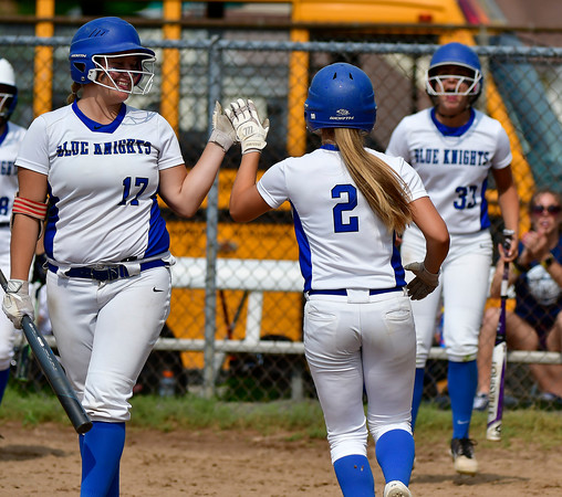 6/1/2019 Mike Orazzi | Staff Southington's Abigail Lamson (17) and Chrisala Marotto (2) during the Class LL Quarterfinal softball game with Ridgefield at Southington High School on Saturday.
