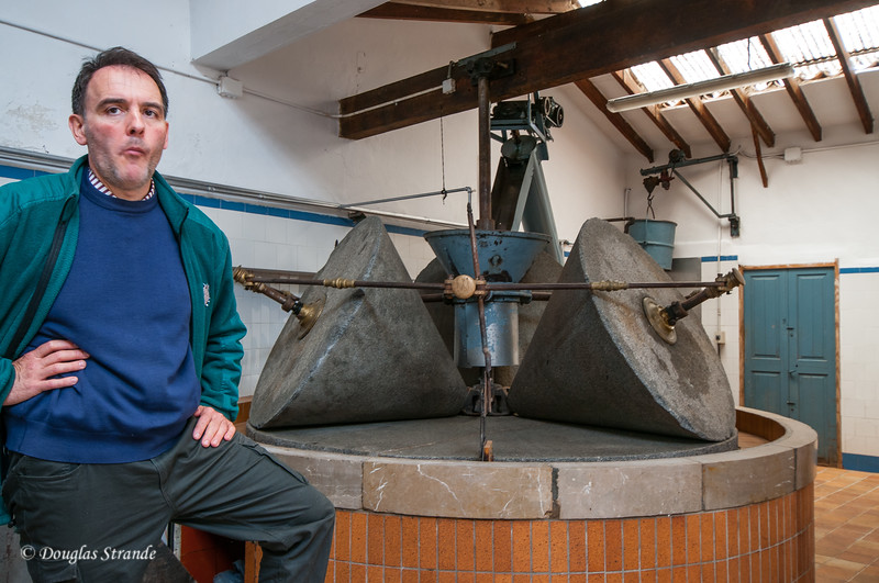 Owner of Can-Det facility with the historic olive crusher in Soller, Mallorca