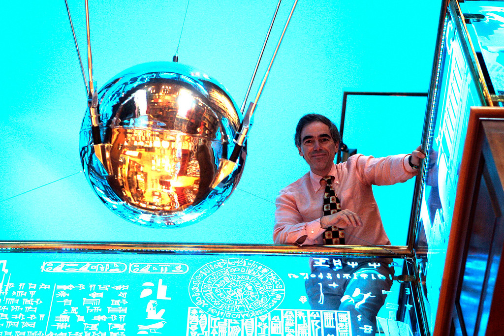 """. Jay Walker poses with his Sputnik satellite in his Ridgefield, Conn., home Friday, Sept. 28, 2007. Walker says that he acquired the spacecraft, which he says is one of the original Sputniks built by the Soviets in 1957 and is neither a model nor a replica, through a listing placed on eBay by a pilot who frequently flew the Moscow route. Walker is the executive producer of the documentary film \""""Sputnik Mania\""""  that is being brought out in connection with the 50th anniversary of the launch of the original Sputnik on Oct. 4, 1957.  Walker is the founder of Priceline.com.  (AP Photo/Bob Child)"""