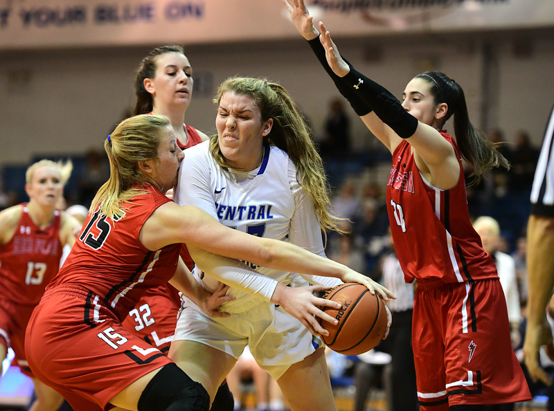 1/19/2019 Mike Orazzi | Staff CCSU's Ashley Berube (33) and Saint Francis University's Haley Thomas (15) during Saturday's women's basketball game in New Britain.