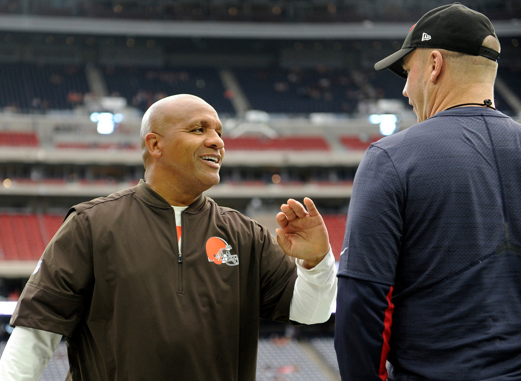 . Cleveland Browns head coach Hue Jackson and Houston Texans head coach Bill O\'Brien, right, talk on the field during warm ups before an NFL football game, Sunday, Oct. 15, 2017, in Houston. (AP Photo/Eric Christian Smith)