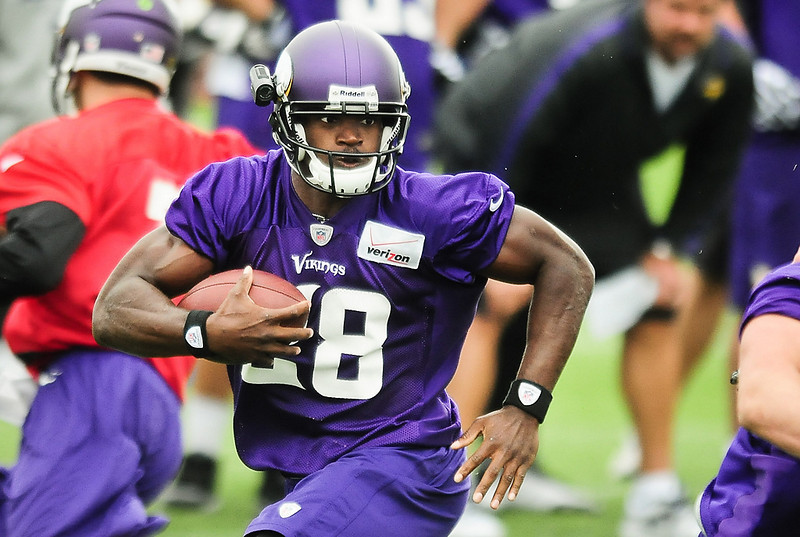 . Minnesota Vikings running back Adrian Peterson on a run at Vikings training camp in Mankato, Minn., on Friday, July 26, 2013. (Pioneer Press: Ben Garvin)