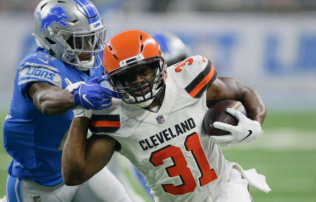 . Cleveland Browns running back Nick Chubb (31) is tackled by Detroit Lions defensive back DeShawn Shead during the first half of an NFL football preseason game, Thursday, Aug. 30, 2018, in Detroit. (AP Photo/Duane Burleson)