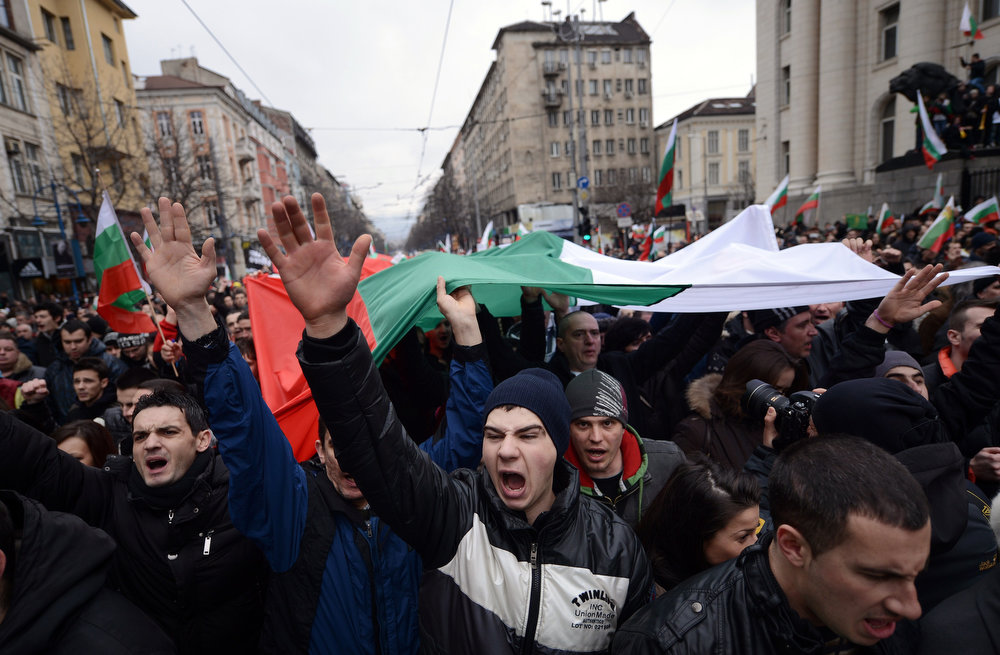 Description of . Protesters shout slogans during a protest in Sofia on February 24, 2013. Tens of thousands of protesters rallied across Bulgaria on Sunday to denounce austerity measures and corruption plaguing the country, just days after the right-wing government was forced to resign. DIMITAR DILKOFF/AFP/Getty Images