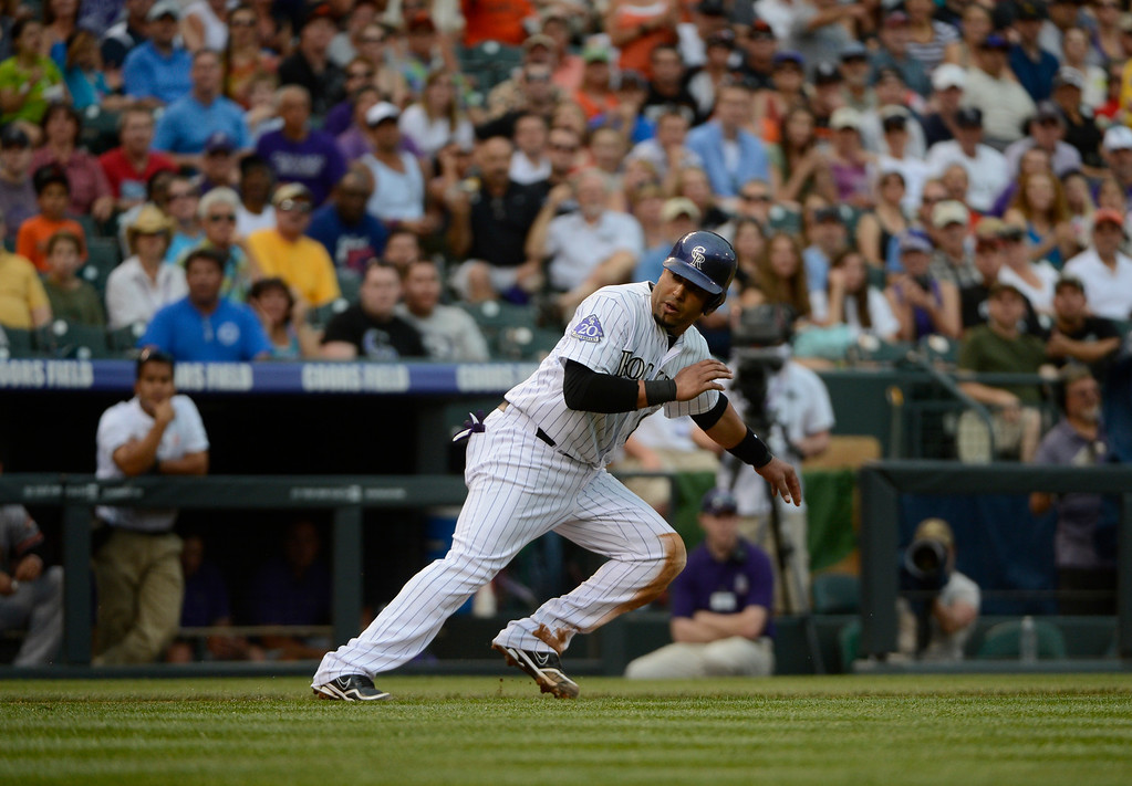 . DENVER, CO - JUNE 27: Colorado Rockies catcher, Yorvit Torrealba gets caught in a pickle against the San Francisco Giants at Coors Field Saturday afternoon, June 29, 2013. (Photo By Andy Cross/The Denver Post)