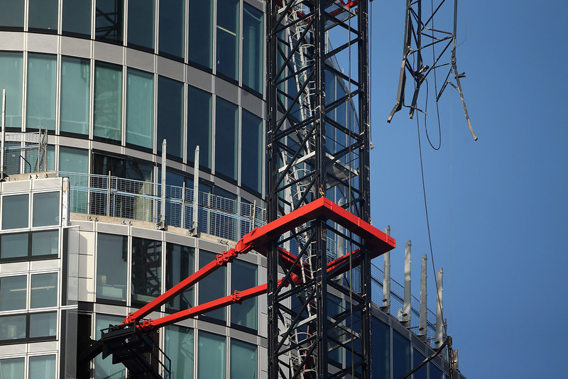 . A damaged crane attached to St Georges Wharf Tower after a helicopter collided with it, in Vauxhall, on January 16, 2013 in London, England. According to reports, the helicopter hit the crane before plunging into the road below during the morning rush hour.  Two people died and nine casualties have been confirmed with one in a critical condition. (Photo by Dan Kitwood/Getty Images)