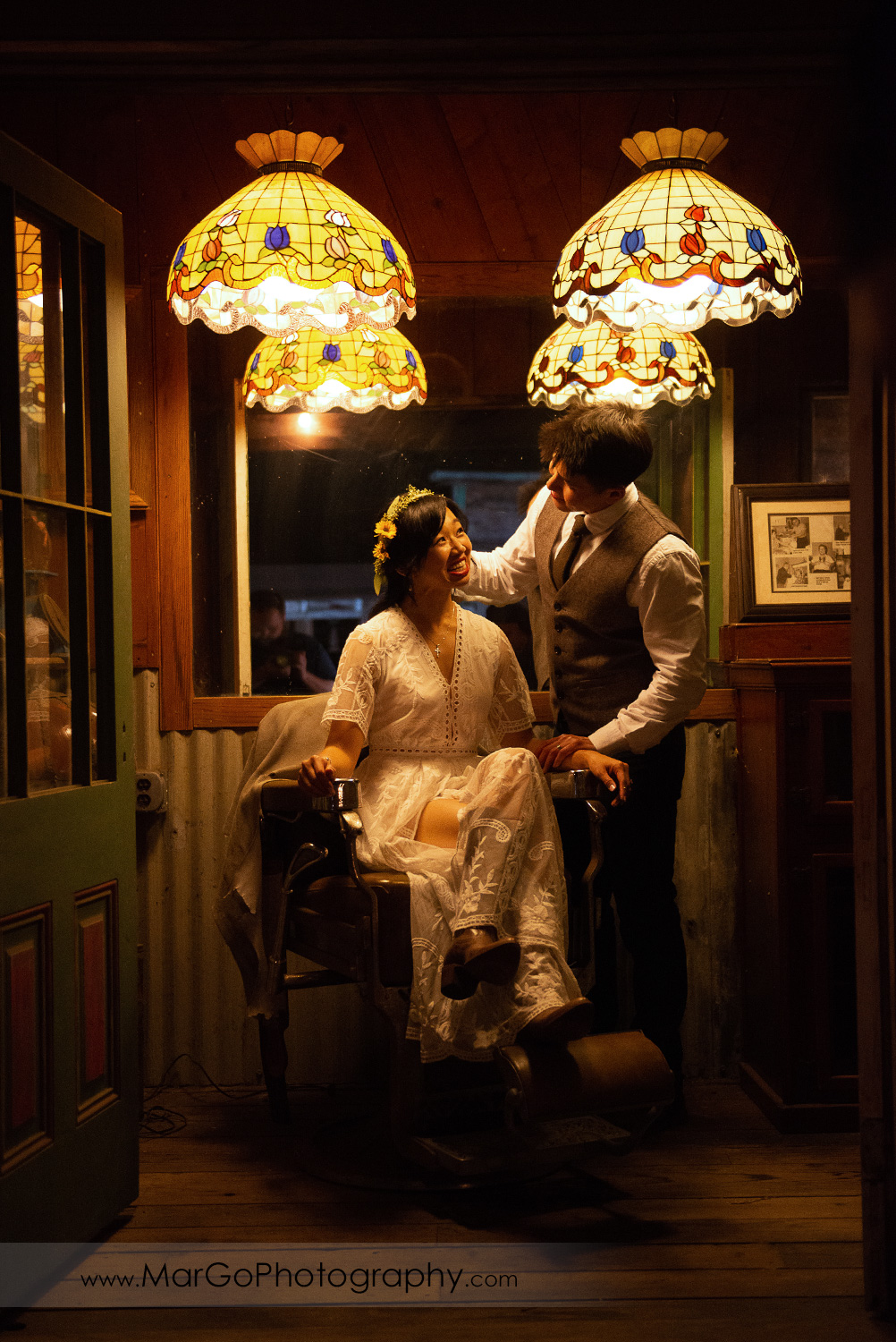 bride and groom in the old school barber shop at Long Branch Saloon & Farms in Half Moon Bay