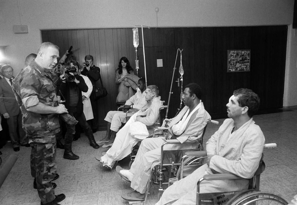 . In this Oct. 25, 1983, file photo, U.S. Marine Corps Commandant Paul Kelley, left, awarded the Purple Heart to Marines wounded in the terrorist bombing in Beirut during a ceremony at the Wiesbaden Air Force hospital, in Germany. At right (from back to front) Renard Manley (Panama City, Fla.), Michael Balcon (Vernon, N.Y.), Elvin H. Henry (Columbia, S.C.) and Pedro J. Alvaredo (Ponce, Puerto Rico). The blast _ the single deadliest attack on U.S. forces abroad since World War II _ claimed the lives of 241 American service members. (AP Photo/Udo Weitz, File)