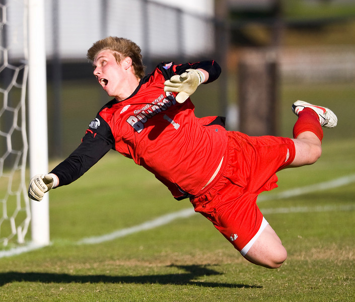 """Gardner Webb goal keeper Trent Kozman watches as the ball is out of his reach, the surprise on his face, """"priceless"""""""