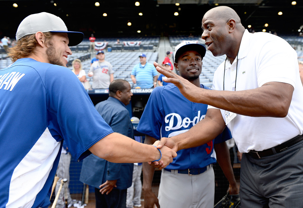. Magic Johnson talks with Clayton Kershaw and Dee Gordon as they take the field before game 2 of the playoffs Thursday, October 3, 2013 at Turner Field in Atlanta, Georgia. (Photo by Sarah Reingewirtz/Pasadena Star- News)