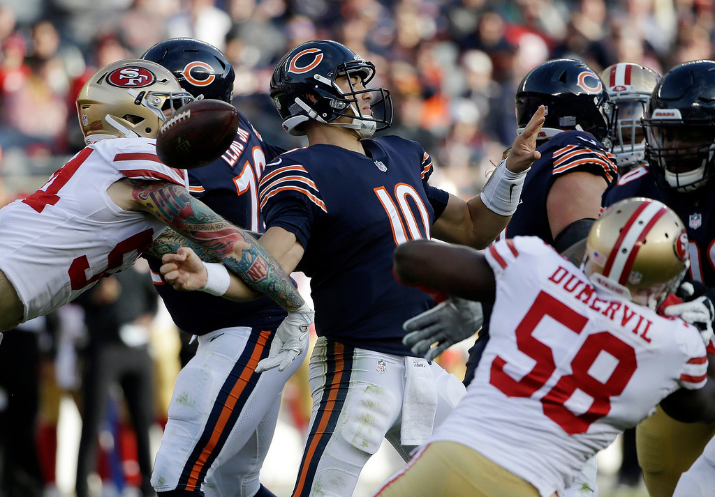 . San Francisco 49ers defensive end Cassius Marsh, left, causes a fumble Chicago Bears quarterback Mitchell Trubisky tries to throw a pass during the second half of an NFL football game, Sunday, Dec. 3, 2017, in Chicago. (AP Photo/Nam Y. Huh)