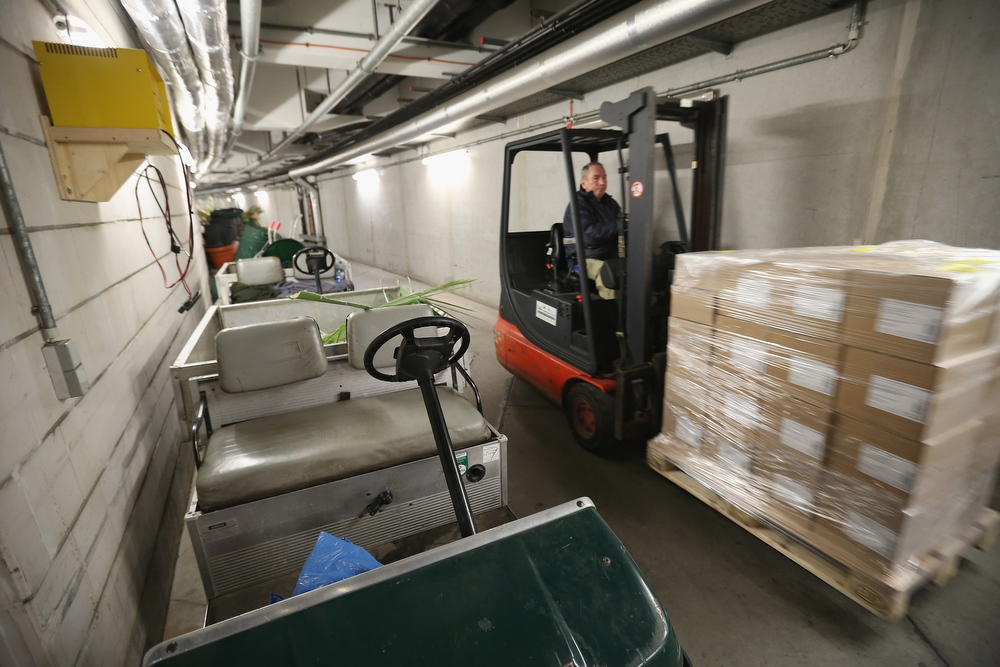 . A worker drives a forklift through the warren of passages under the Tropical Islands indoor resort on February 15, 2013 in Krausnick, Germany. Located on the site of a former Soviet military air base, the resort occupies a hangar built originally to house airships designed to haul long-distance cargo. Tropical Islands opened to the public in 2004 and offers visitors a tropical getaway complete with exotic flora and fauna, a beach, lagoon, restaurants, water slide, evening shows, sauna, adventure park and overnights stays ranging from rudimentary to luxury. The hangar, which is 360 metres long, 210 metres wide and 107 metres high, is tall enough to enclose the Statue of Liberty.  (Photo by Sean Gallup/Getty Images)