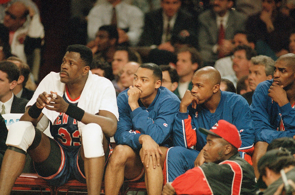 . The New York Knicks Patrick Ewing, left, Corey Gaines, Anthony Mason and Charles Smith, right, watch the action late in the fourth quarter during their 93-79 loss to the Chicago Bulls, Friday, May 20, 1994, Chicago, Ill.  (AP Photo/Fred Jewell)