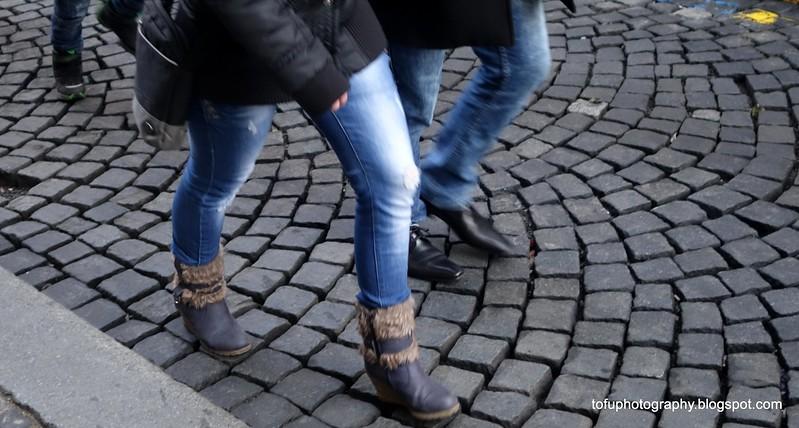 Women walking on cobblestones in Prague, Czech Republic in February 2014