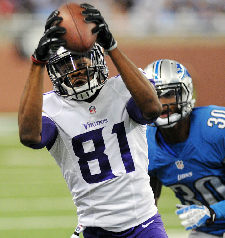 . Vikings wide receiver Jerome Simpson catches a pass for a first down in the third quarter; defending is Lions defensive back Darius Slay.  (Pioneer Press: Chris Polydoroff)