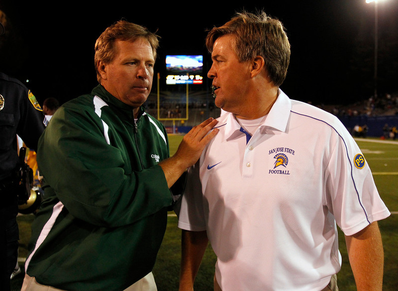 . San Jose State University Spartans head coach Mike MacIntyre, right, meets with Colorado State University Rams head coach Jim McElwain, left, after the Spartans 40-20 win at Spartan Stadium in San Jose, Calif. on Saturday, Sept. 15, 2012.  (Nhat V. Meyer/Staff)