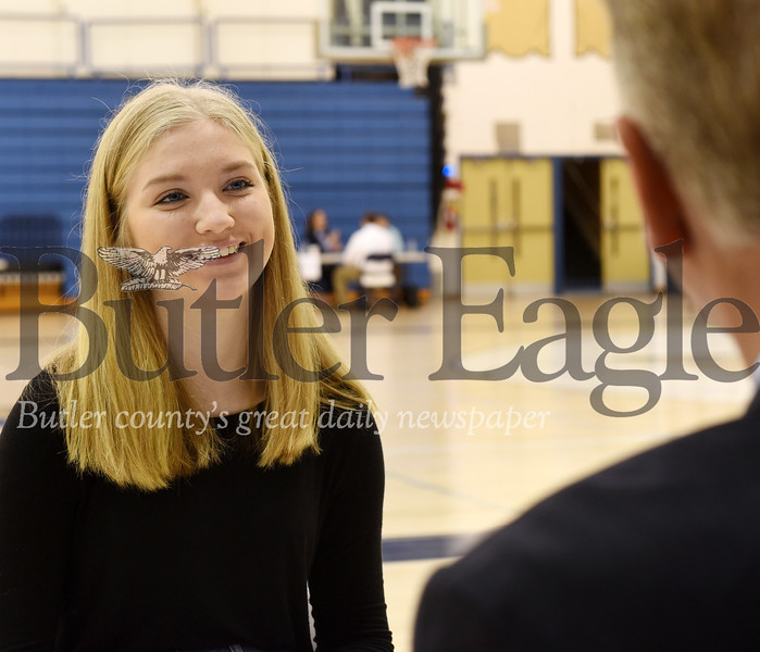 Harold Aughton/Butler Eagle: Butler 11th grader, Katlynn Lawrence listens to the advice of Special Agent Ronald Pate of the Pennsylvania Attorney General's Office.