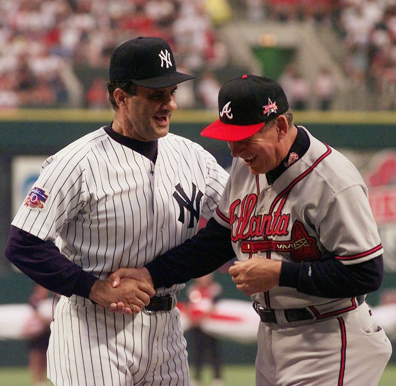 . New York Yankees and American League All-Star manager Joe Torre, left, and Atlanta Braves and National League All-Star manager Bobby Cox shake hands prior to the start of  the 68th All-Star Game Tuesday July 8, 1997 in Cleveland. (AP Photo/Mark Duncan/Pool)