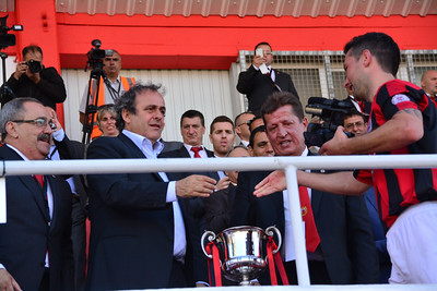 Lincoln Red Imps completed a triple affirming their place as the leading football team in Gibraltar after beating College 1-0 in the Rock Cup Final at Victoira Stadium, the first since Gibraltar joined UEFA. The captain approached the President of UEFA witha camera on hand as he received his trophy.