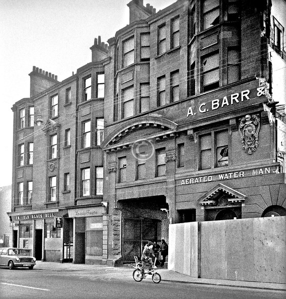Gallowgate.  The A.G.Barr  factory with demolition under way. The linked tenement has been spared, and the Old Black Bull is still in business.    March 1976