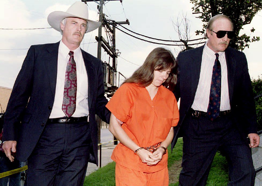 Description of . Branch Davidian member Kathryn Schroeder is lead by Federal Marshals to her arraignment on March 16, 1993 at the Federal Courthouse in Florida. Schroeder was released from the besieged Branch Davidian compound on March 12, 1993 along with Australian Oliver Gyarfas.  The armed standoff at the compound is in its 17th day. BOB PEARSON/AFP/Getty Images