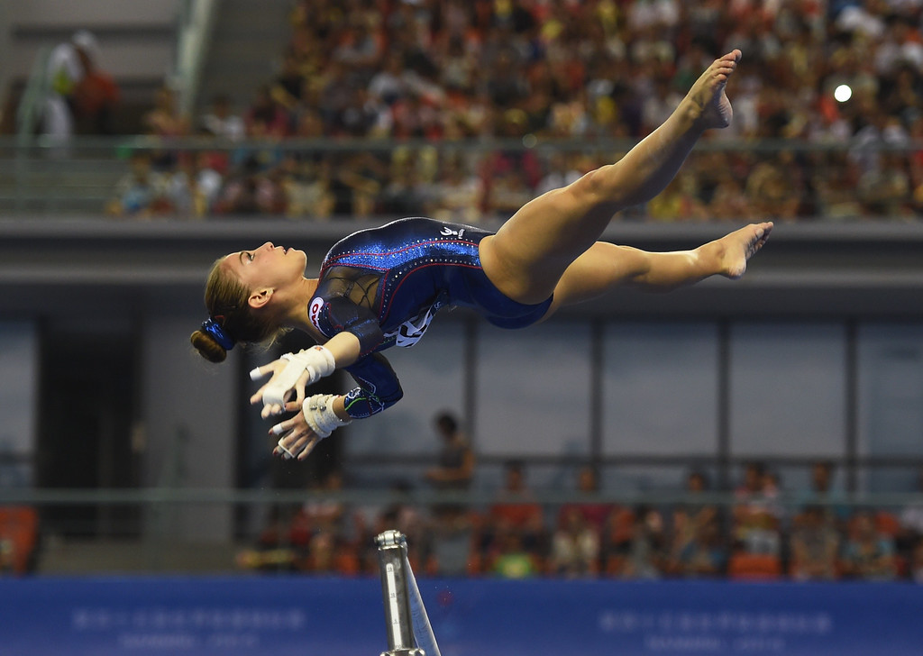 . Italy\'s Lara Mori performs on the uneven bars during the women\'s qualification round at the Gymnastics World Championships in Nanning, in China\'s southern Guangxi province on October 6, 2014.GREG BAKER/AFP/Getty Images