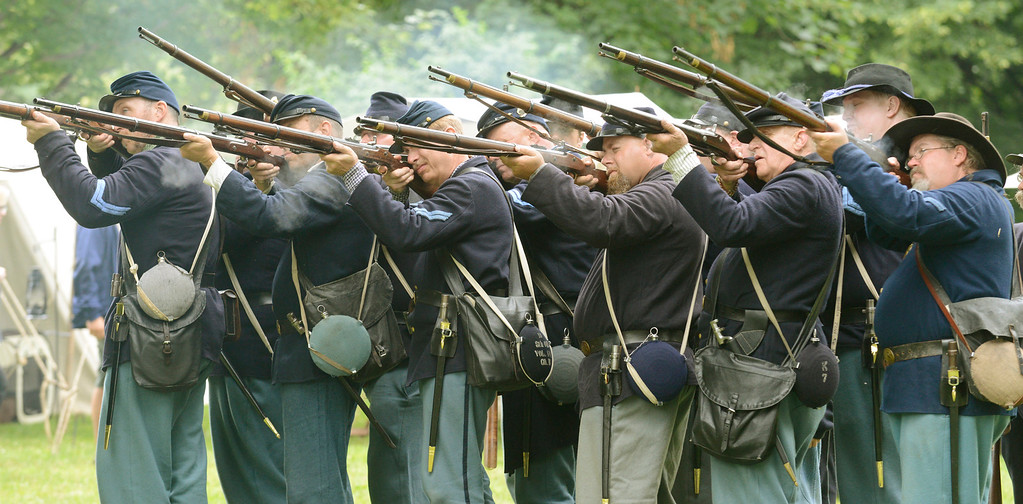 . A group of men, representing the Union Army 7th, 8th and 66th regiments, re-enact firing drill practices during the 2014 Civil War Encampment at the James A. Garfield National Historic Site in Mentor. The 2017 edition of the encampment weekend will be July 14-16. For more information, visit nps.gov/jaga/civil-war-weekend-2017.htm. (News-Herald file)