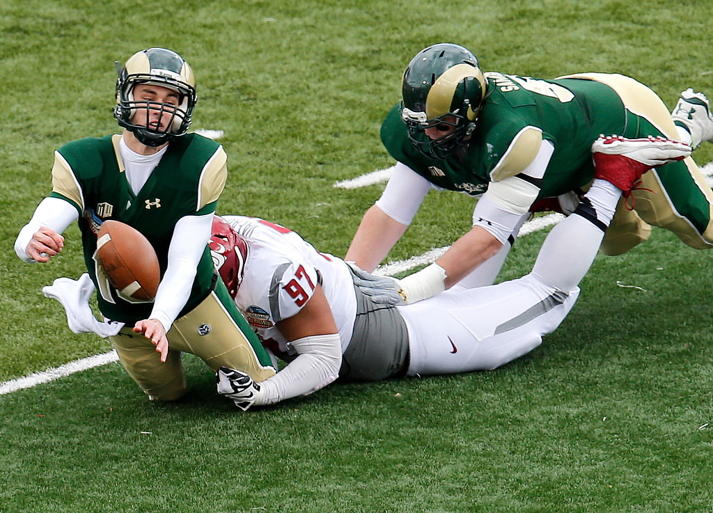 . Colorado State quarterback Garrett Grayson is sacked by Washington State defensive lineman Destiny Vaeao (97) as Colorado State\'s Johnny Schupp tries to block during the first half of the New Mexico Bowl NCAA college football game, Saturday, Dec. 21, 2013, in Albuquerque, N.M. (AP Photo/Matt York)