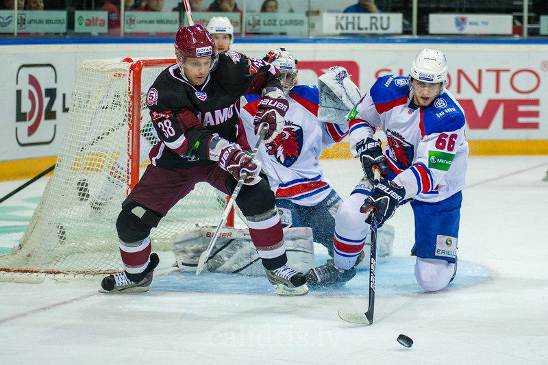 Juraj Mikus (66) kicks the puck from the front of the goal
