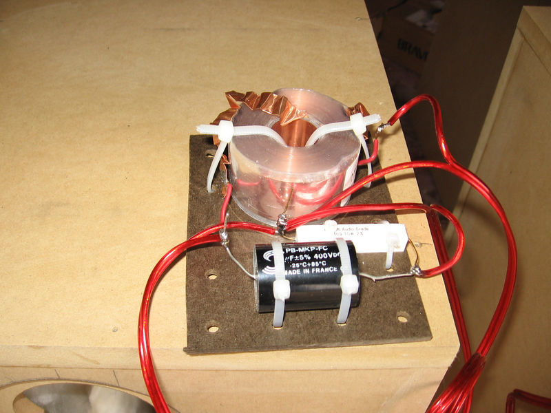 A crossover ready for installation. It's a very SET-friendly first order consiting of an inductor in series with the woofer and a capacitor is series with the tweeter. A resistor is placed across the tweeter leads to damp any resonance. I used a copper foil inductor because I had in in the parts bin, but the copper wire inductor supplied with the kit will work just as well.