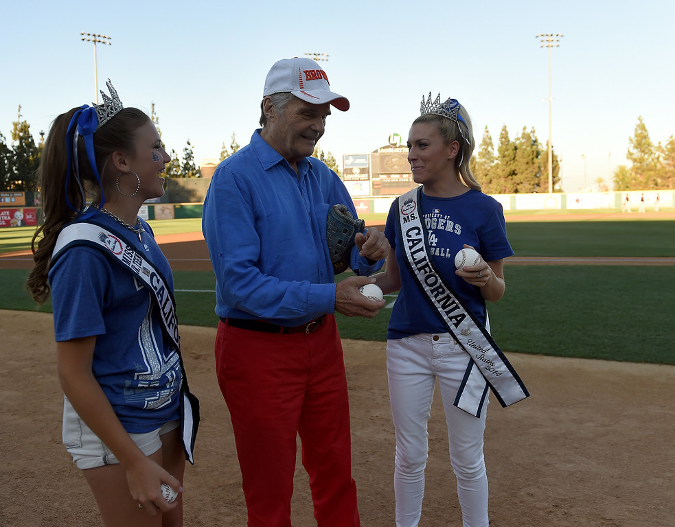 . Ms. Jr. Teen California Alina Carranza, left, Actor Fred Willard and Ms. California 2014 Sande Charles prepare to throw out the first pitches at the Quakes game at LoanMart Field in Rancho Cucamonga, CA, Friday, August 15, 2014. (Photo by Jennifer Cappuccio Maher/Inland Valley Daily Bulletin)