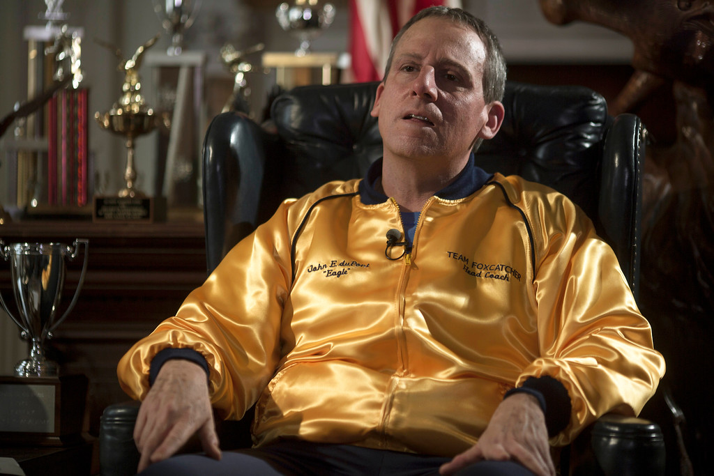 """. This image released by Sony Pictures Classics shows Steve Carell in a scene from \""""Foxcatcher.\"""" Carell portrays John du Pont, a millionaire convicted of third-degree murder in the death of Dave Schultz, an Olympic champion freestyle wrestler.  He was nominated for a Golden Globe for best actor in a drama for his role in the film on Thursday, Dec. 11, 2014. The 72nd annual Golden Globe awards will air on NBC on Sunday, Jan. 11. (AP Photo/Sony Pictures Classics, Scott Garfield)"""