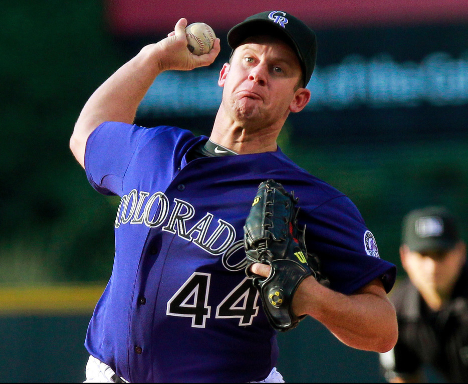 . Colorado Rockies starting pitcher Roy Oswalt throws to a Los Angeles Dodgers batter during the first inning of a baseball game Tuesday, July 2, 2013, in Denver. (AP Photo/Barry Gutierrez)