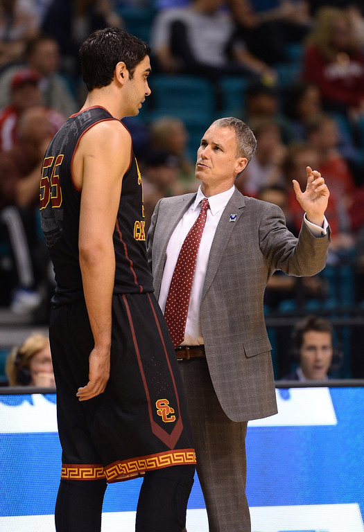 . Head coach Andy Enfield of the USC Trojans talks with Omar Oraby #55 during a first-round game of the Pac-12 Basketball Tournament against the Colorado Buffaloes at the MGM Grand Garden Arena on March 12, 2014 in Las Vegas, Nevada.  (Photo by Ethan Miller/Getty Images)