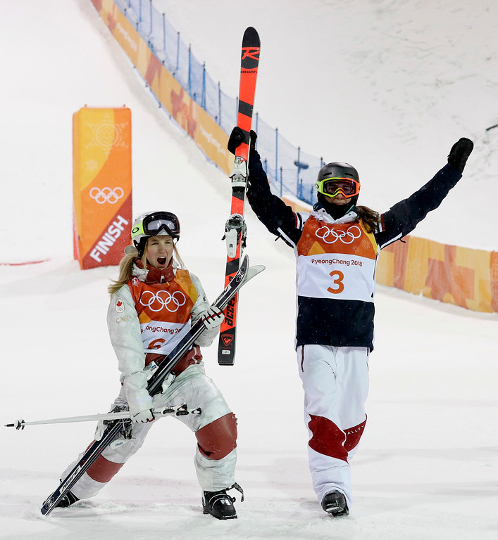 . Gold medal winner Perrine Laffont, of France, right, and Silver medal winner Justine Dufour-Lapointe, of Canada, celebrate after the women\'s moguls finals at Phoenix Snow Park at the 2018 Winter Olympics in Pyeongchang, South Korea, Sunday, Feb. 11, 2018. (AP Photo/Kin Cheung)