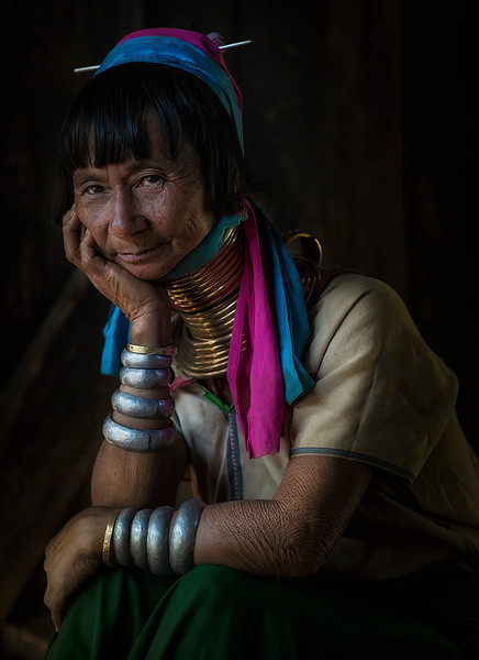 The Kayan originate in Burma (today Myanmar), from the Karen State. Most of them escaped the war and the regime violating their human rights in their homeland. Burmese Shan call them the Padaung. Only small fraction of the Kayan, or more precisely their women and girls, wear the brass neck-rings (it is actually one long spiral), which depresses their shoulders and therefore cause the woman's neck to look longer. This gave the people their unflattering nickname the 'long necks'.  Kayah State, Myanmar, 2017