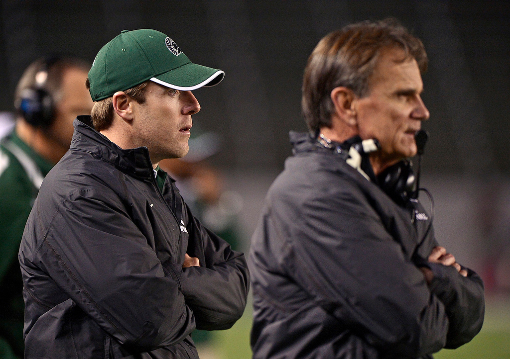 . De La Salle Spartans\' assistant coach Justin Alumbaugh, left, stands next to head coach Bob Ladouceur as they play the Centennial Huskies in the fourth quarter in the Open Division during the 2012 CIF State Football Championship at Home Depot Center in Carson , Calif. on Saturday, Dec. 15, 2012. De La Salle defeated Centennial 48-28. (Jose Carlos Fajardo/Staff)