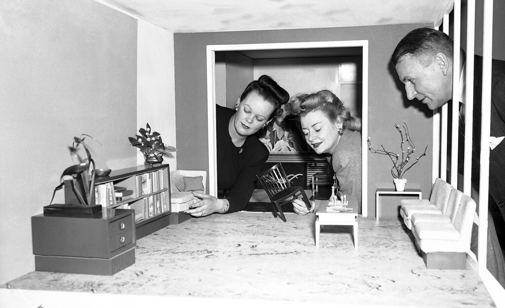 . This outside doll house is being used to study decorating problems at a store (Bamberger?s) in Newark, N.J., on Jan. 20, 1948. Peggy Pantley and Marie Hagen are adjusting furniture in the miniature living room of the two-room model unit. It is to be used by store personnel in a new course of study. With movable floors, walls and ceilings, the miniature unit can be used to try out various furniture and color arrangements which would be too expensive to experiment with on a large scale. The doll house is part of a project set up by the store and Pratt Art Institute of Brooklyn, N.Y., for an interchange of ideas and education. (AP Photo/Dan Grossi)