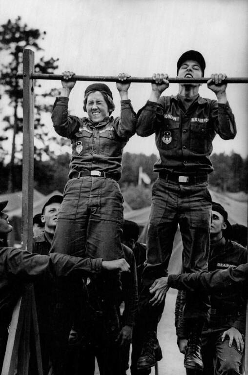 . Wilcock and another female basic do pull-ups before they can go to lunch. Because they have less upper-arm strength than the men, some of the female basics did an arm hang for time. We are here to build ourselves up, said one woman. 1976. The Denver Post Library Archive
