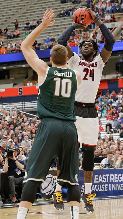 . Louisville\'s Montrezl Harrell (24) shoots over Michigan State\'s Matt Costello (10) during the first half of a regional final in the NCAA men\'s college basketball tournament Sunday, March 29, 2015, in Syracuse, N.Y. (AP Photo/Seth Wenig)