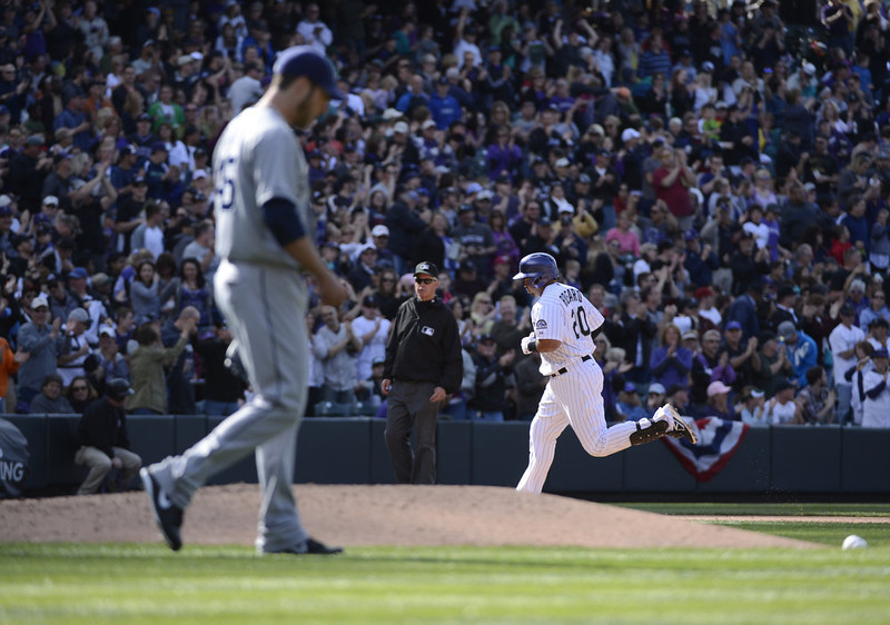 . Colorado Rockies Wilin Rosario (20) rounds third base after hitting a three-run home run off of San Diego Padres pitcher Anthony Bass (45) in the seventh inning  April 7, 2013 at Coors Field. (Photo By John Leyba/The Denver Post)