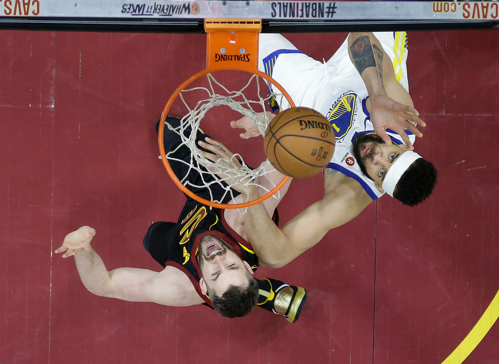 . Golden State Warriors\' JaVale McGee, right, and Cleveland Cavaliers\' Kevin Love look for for a rebound in the second half of Game 3 of basketball\'s NBA Finals, Wednesday, June 6, 2018, in Cleveland. (AP Photo/Carlos Osorio, Pool)