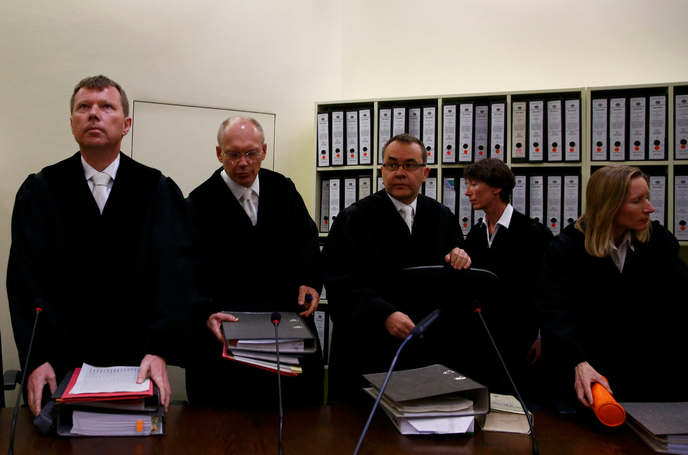 . Chief Judge Manfred Goetzl (2L) stands in the court before the start of the trial of Beate Zschaepe, a member of the neo-Nazi group National Socialist Underground (NSU), in Munich May 6, 2013.    REUTERS/Michael Dalder