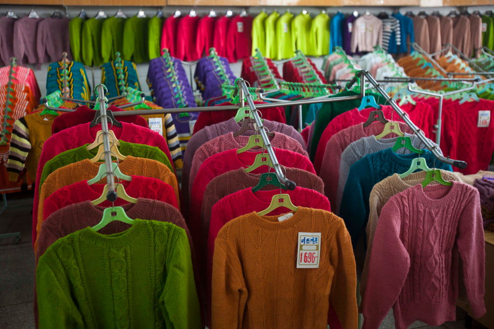 Description of . North Korean-made sweaters are displayed for sale at Pyongyang Department Store No. 1 in downtown Pyongyang, North Korea on Sunday Oct. 9, 2011. It's hard to imagine a North Korea without Kim Jong Il, who led the nation for 17 years until his death on Dec. 17, 2011. His death marks the end of an era for North Korea, which has known only two leaders: Kim and his father, Kim Il Sung. Already, a new era has begun under the leadership of his young son, Kim Jong Un.  (AP Photo/David Guttenfelder)