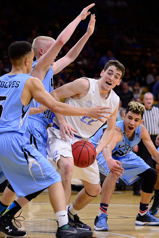 . Jacob Wilkinson (22) of Pueblo West looks for a way out of a slew of Vista Ridge defenders during the fourth quarter at the Coors Events Center on March 11, 2016 in Boulder, Colorado. Pueblo West defeated Vista Ridge 65-54 to advance to the 4A finals of Colorado state basketball tournament.  (Photo by Brent Lewis/The Denver Post)