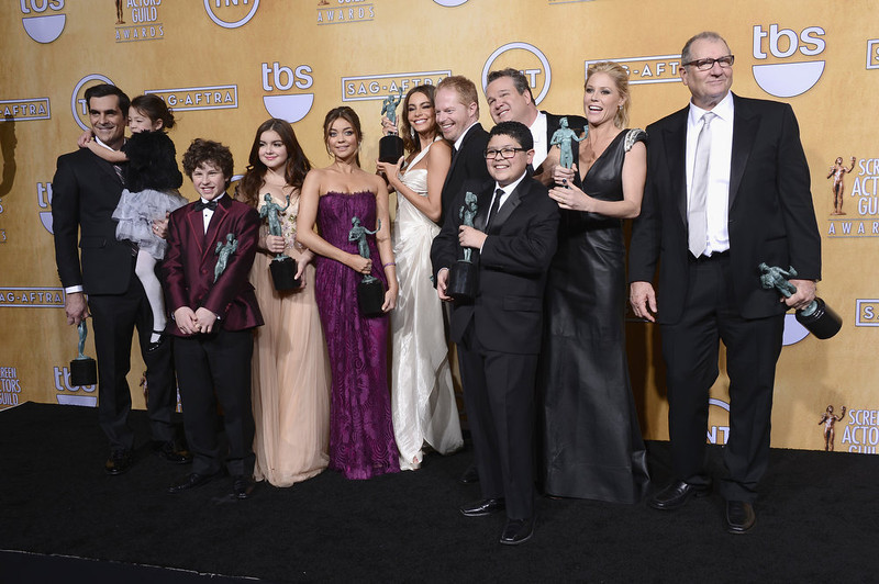 """. Actors Ty Burrell, Aubrey Anderson-Emmons, Nolan Gould, Ariel Winter, Sarah Hyland, Sofia Vergara, Jesse Tyler Ferguson, Eric Stonestreet, Rico Rodriguez, Julie Bowen and Ed O\'Neill, winners of Outstanding Performance by an Ensemble in a Comedy Series for \""""Modern Family,\"""" pose in the press room during the 19th Annual Screen Actors Guild Awards held at The Shrine Auditorium on January 27, 2013 in Los Angeles, California.  (Photo by Frazer Harrison/Getty Images)"""