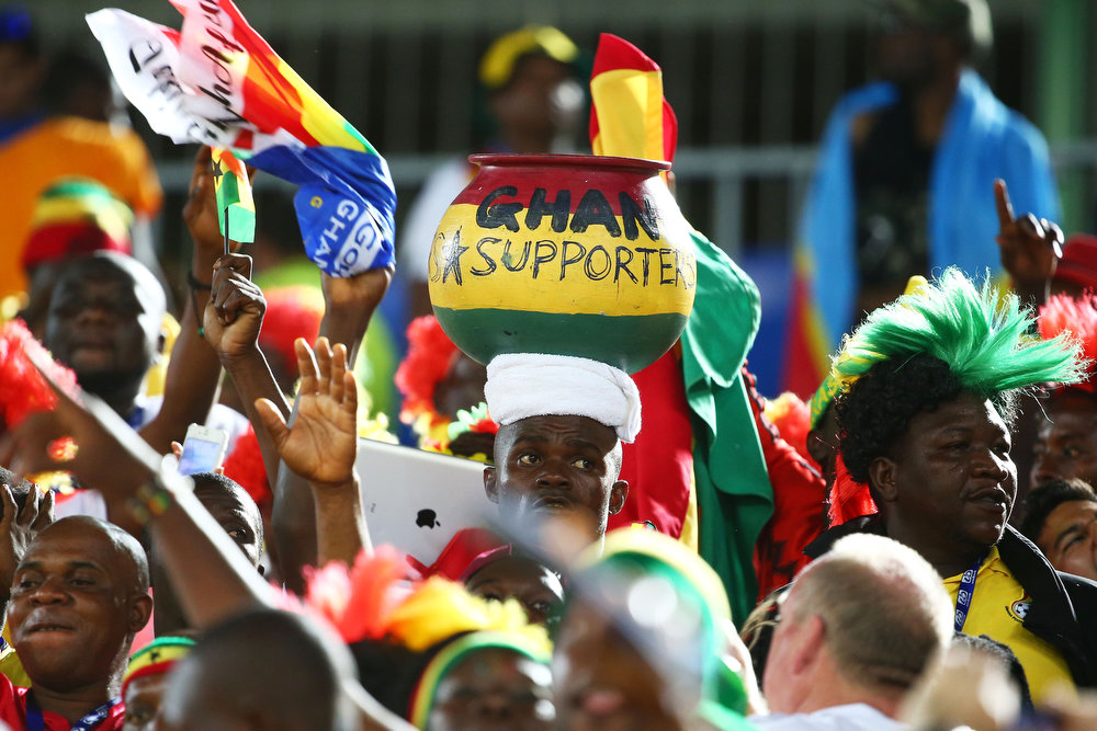 Description of . Ghana fans cheer prior to the 2014 FIFA World Cup Brazil Group G match between Ghana and the United States at Estadio das Dunas on June 16, 2014 in Natal, Brazil.  (Photo by Robert Cianflone/Getty Images)